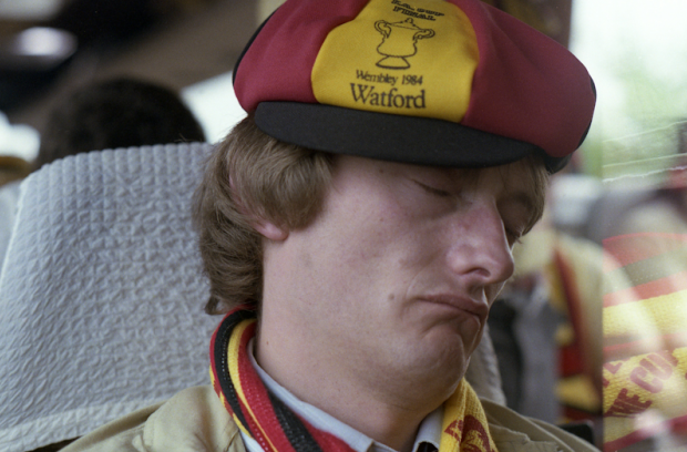 Watford fan resting after a disappointing result