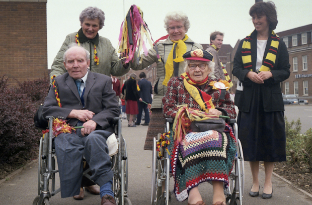 Elderly disabled fans outside Watford Town Hall